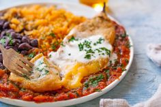 This authentic chile relleno recipe is a traditional Mexican dish of flavorful chilies stuffed with cheese, battered & fried, & smothered in homemade sauce. Authentic Chile Relleno Recipe, Traditional Mexican Dishes, Rellenos Recipe, Creamy Potato Salad, Mexican Food Recipes, Ethnic Recipes, Mexican Meals, Homemade Sauce