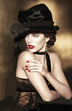 Model: Emily DiDonato wearing Nina Ricci dress, LV hat, Chanel earrings for Vogue Latin America Ocotober 2012 by Photographer: Matthew Scrivens