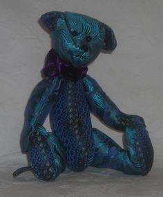 Misha. He is made from 2 beautiful silk mens' tie fabrics. www.facebook.com/TBearspicnic