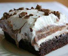 Brownie Refrigerator Cake  Ingredients  2 brownie mixes  1 extra large egg  1 (8 oz.) package cream cheese, softened  1 cup powdered sugar  2 (8 oz.) containers whipped topping  1 (3 oz.) package instant chocolate pudding  1 (3 oz.) package instant vanilla pudding  3½ cups milk  1 Hershey candy bar or chocolate syrup