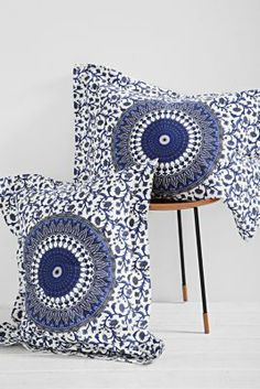 Magical Thinking River Medallion Sham Set- Fun patterned pillows that will bounce of any brightly colored comforter. This blue and a bright orange< like UT> would go fittingly.