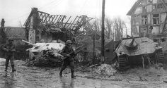 After the heavy fighting occurred in the town of Kesternich, two American soldiers of the 78th Infantry Division, move ahead of two Hetzer destroyed, the January 31 d 1945.