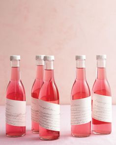 Delicious (and DIY) Wedding Favors Raspberry Vodka - Mixing these totable potables is as easy as whipping up fruit-infused booze, pouring it into bottles, and tying on a recipe for a Rasmopolitan cocktail. Edible Wedding Favors, Wedding Favors For Guests, Bridal Shower Favors, Party Favors, Wedding Gifts, Edible Favors, Wedding Souvenir, Bridal Gifts, Do It Yourself Wedding