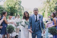 #alessiabweddings wedding planner www.alessisbweddings.com Image by  Sara Lincoln Photography - Rime Arodaky gown for a Tuscany wedding with a white and grey colour scheme and bridesmaid dresses from ASOS.