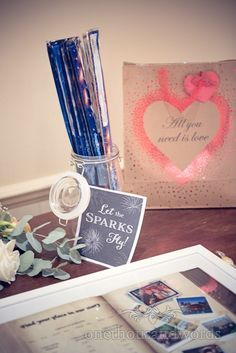 Jar of sparklers and table plan from Bournemouth Hotel Wedding. Photography by one thousand words wedding photographers