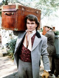 American actor Patrick Swayze carrying a trunk as Orry Main in the TV miniseries 'North And South' 1985 North And South, Lisa Niemi, Civil War Movies, Mejores Series Tv, Patrick Wayne, Jennifer Grey, Dirty Dancing, American Actors, I Movie