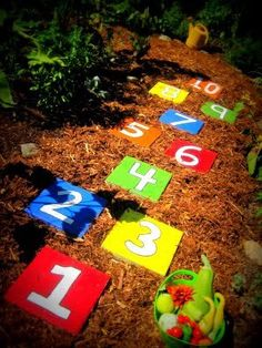 number color stepping stones in the garden for the area behind the classrooms ... bright colors, numbers, shapes, bugs, flowers, butterflies, etc...
