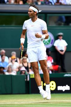 Rafael Nadal of Spain celebrates winning a point against Jiri Vesely of the Czech Republic during their Men's Singles fourth round match on day seven of the Wimbledon Lawn Tennis Championships at All England Lawn Tennis and Croquet Club on July 9, 2018 in London, England.