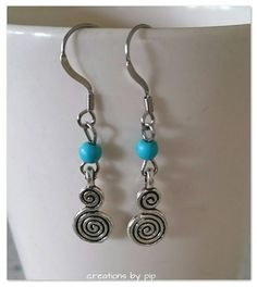 Check out this item in my Etsy shop https://www.etsy.com/uk/listing/241749379/silver-swirl-earrings-with-turquoise