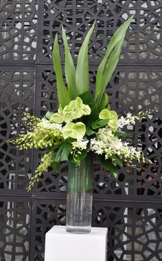 I LOVE this arrangement with greens and orchids