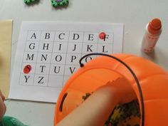 Draw and Stamp- This is a fun way to work on identifying letters. Put letters (magnetic letters, foam letters, or letters on paper) into a bucket. Have your child draw a letter out of the bucket, find it on the page, and stamp it (or put a sticker on it, or color it in, etc.) Continue until an entire row or page is filled.