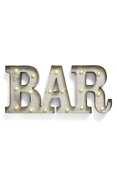 Free shipping and returns on CREATIVE CO-OP 'BAR' LED Marquee Sign at Nordstrom.com. Illuminate your home bar space with a festive, glowing marquee sign crafted in antiqued metal for on-trend vintage appeal. The letters are battery-operated for custom display, and a built-in timer makes for hassle-free operation.