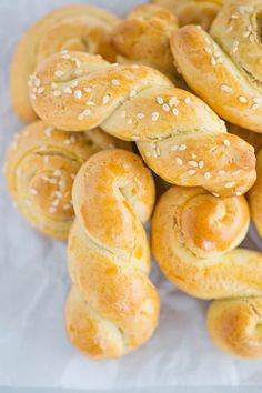 Koulourakia :: Traditional Greek Easter cookies that are infused with orange zest and perfect for dunking in coffee. Use baking ammonia for a fully authentic cookie! #cookies #holidays #holidaybaking #Greekfood #Easter #EasterRecipes #GreekRecipes via @browneyedbaker
