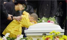 This image still tugs at my heart....Kevin Villa, 8 mourns the loss of his mother who died at the World Trade center.