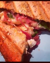 Toasted sandwich with brie, proscuitto and basil