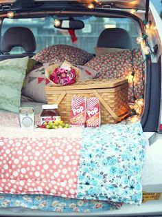 Drive in theater. Project a movie onto a white bed sheet. hung from the garage door then sit in the driveway and watch the movie.
