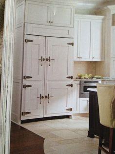 Fridge behind cabinets