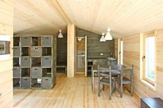 DublDom is a tiny modular cottage manufactured in Russia. It has a 280 sq ft studio floor plan. | www.facebook.com/SmallHouseBliss