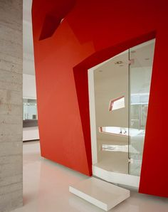 faceted red volume in a Shanghai office, designed by Architecture Studio of Rome and Shanghai, houses two meeting rooms and a cafe. Concrete Interiors, Window Furniture, Colour Architecture, Retail Interior, Red Walls, Dezeen, Office Interiors, Colorful Interiors, Meeting Rooms