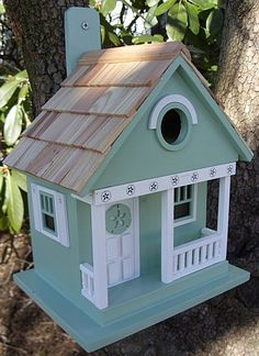 Part of our Beachcomber Collection of whimsical, fully functional birdhouses, the Cottage Birdhouse features a classic motif with &ldquopunched-out&ldquo details along the porch and side window trims. Decorative Bird Houses, Bird Houses Painted, Bird Houses Diy, Fairy Houses, Teal Bird, Bird House Kits, Bird Boxes, Backyard Birds, House Painting