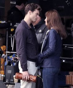 Jamie Dornan & Dakota Johnson on set of Fifty Shades of Grey in Vancouver - 14 Oct 2014 Click on for more FSOG Set photos lovefiftyshades.com | twitter | instagram | pinterest | youtube