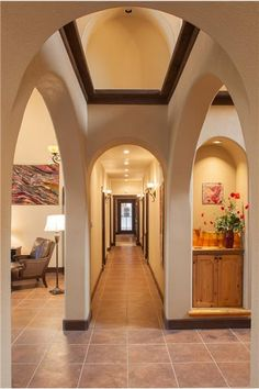 Arches and high ceiling in the great room. Hallway from the mian entreance and opens to the kitchen and dinnning area. Beautiful flow from rooms. #wallhangings #tapestries #handmade by local artist, Marianne Williamson. Ranch for sale!