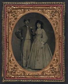 Unidentified soldier in Union sergeant's frock coat and forage cap with unidentified woman in dress and hat with veil. Between 1860 and 1865