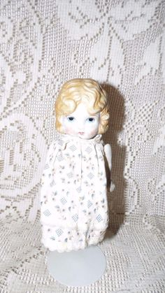 ANTIQUE BISQUE PORCELAIN BLONDE DOLL JOINTED ARMS MADE IN JAPAN W/STAND