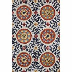 """An artful anchor for your master suite or dining room, this hand-tufted wool rug showcases a suzani-inspired medallion motif in navy.  Product: RugConstruction Material: WoolColor: Ivory and navyFeatures:  Hand-tuftedLoop pile   Pile Height: 0.5"""" Note: Please be aware that actual colors may vary from those shown on your screen. Accent rugs may also not show the entire pattern that the corresponding area rugs have.Cleaning and Care: Regular vacuuming. Spot cleaning recommended. Rug pad ..."""