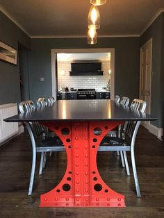 Industrial dining table constructed with genuine hot rivets and architectural steel tie bars. Authentic Victorian engineering for the modern age. The table can be finished in any colour and can be supplied with a top of your choice, from live-edge wooden slabs to concrete or