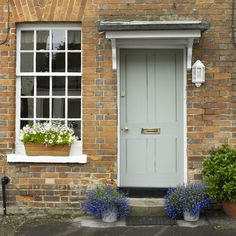 Front door color. Window box. Blue lobelia pots.