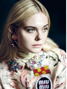 Ready for her closeup, Elle Fanning wears Miu Miu coat