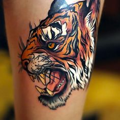 Really cool tiger head on the thigh.