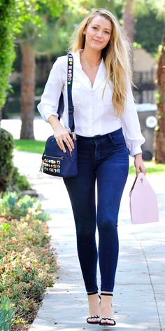 Blake Lively's Chic Street Style - July 30, 2017: Lively made a pair of Old Navy Rockstar 24/7 skinny jeans and a crisp white button-up with double-breasted pockets look anything but basic. She accessorized with a blue Fendi studded backpack and a pair of pearl-studded ankle strap heels.