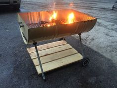 Plus some wood and a cheap charcoal grill legs . Barrel Fire Pit, Barrel Bbq, Oil Barrel, 55 Gallon Drum Smoker, Fire Pit With Rocks, Outdoor Fireplace Designs, Oil Drum, Fire Pit Designs