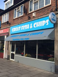 Modern looking fixed triangular canopy with sign writing to the valance and main cover by Deans Blinds And Awnings
