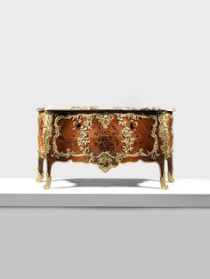 A large French late 19th century gilt bronze mounted tulipwood and amaranth marquetry serpentine commode in the Louis XV style  Important Design, October 25 2017, London