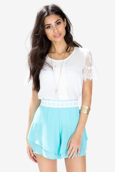 A pair of candy-colored and fluttery soft shorts, featuring a floucy asymmetrical multi-tiered body, lace-trimmed front waistband and elasticized waistband at back. Chiffon. Finished ends. $18.50