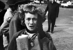 A woman in Manhattan reacts to news of President John F. Kennedy's assassination. November 22, 1963.   (Stan Wayman)