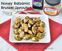 Honey Balsamic Brussel Sprouts.  Sweet and tangy, this recipe will surely get your kids to eat their veggies. #vegetarian #glutenfree #cleaneating #brusselsprouts #roastedvegetables