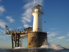 Great shot of Roman Rock Lighthouse in Simons Town. Only lighthouse on SA coastline that is built at sea and on a rock!   www.capepointroute.co.za/seeit-simonstown.php