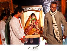 A Bengali Bride's Entrance is special...Called Saat Paak it is a beautiful site to be witnessed only at a Bengali wedding where the bride sits on a wooden stool called a pidi/piri, and is carried to the mandap by her brothers or uncles. The bride is not supposed to see her groom when she enters the mandap, so she has to keep her eyes covered with sacred beetle leaves. Keeping her lifted up on the stool, her brothers' then walk around the groom seven times.