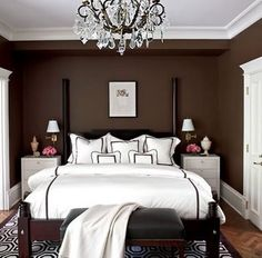 love the contrast of the brown and white. oh, and i want a chandelier in my next bedroom :)