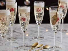 Recipe of the Day: Dazzling Champagne Jelly Flutes Pop bottles before the ball even drops to make dramatic, sparkling champagne jelly flutes for your New Year's Eve festivities. The technique traps the bubbles (and the obligatory raspberry), so they hang suspended in each ready-to-clink flute.