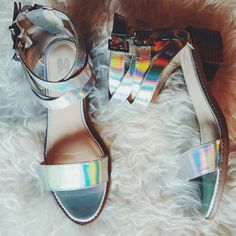 """""""Holographic"""" Sandals I LOVE these sandals...But unfortunately they don't fit me any longer how I'd like. These beautys are from Victoria Secret. They are like a holographic silver. True to Size.  1.5"""" in. heel  Size: 9B  In good condition despite the bottom from wearing a couple of times   I DO NOT TRADE  PRICE IS FIRM (Offers will be declined) Victoria's Secret Shoes Sandals"""