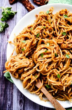 Creamy Sundried Tomato & Avocado Pesto | Vegan, Gluten-free | Heaps of warm pasta are coated in a zesty, tangy, and creamy avocado pesto!