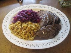 German Cuisine - traditional German food (looks like blaukraut [red cabbage], sauerbraten, and schnitzel (homemade noodles)
