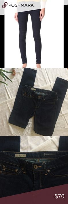 """AG the legging super skinny jeans size 24 Darkwash comfy jeans by Adriano Goldschmied. Inseam is 30"""". Small wear on the back pocket at shown- otherwise these are in 👌🏻 condition! AG Adriano Goldschmied Jeans Skinny"""