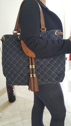 0b59ccb4b7 bolsa jeans e couro com pingente - comprar online