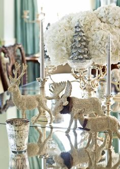 Glittery reindeer look extra lovely on a mirrored surface. - Traditional Home® / Photo: John Bessler / Design: Anthony Catalfano